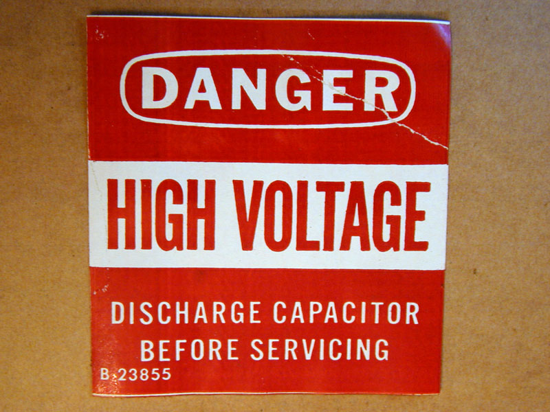 Danger. High voltage. Discharge capaitor before servicing.