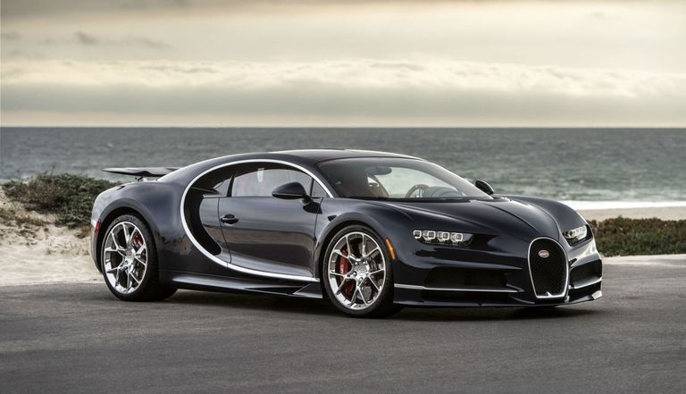 Bugatti Chiron parked in front of a beach