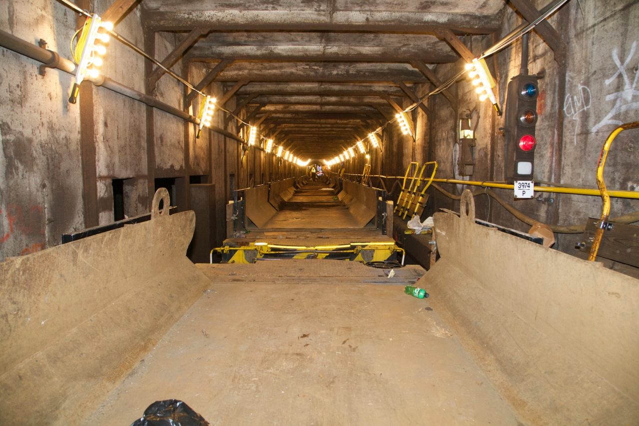 Photo of subway track work illuminated with five light bulb strips