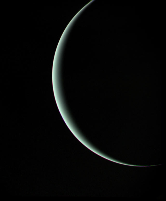 departing crescent view of uranus