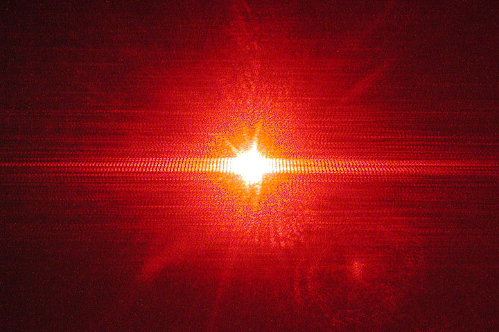 Single slit interference of a red laser through a small opening