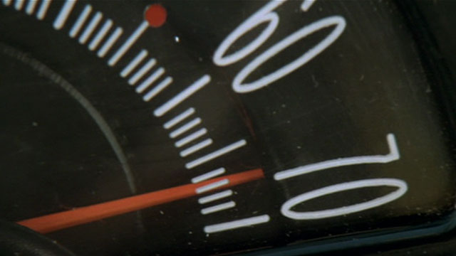 Analog speedometer showing 67 mph.