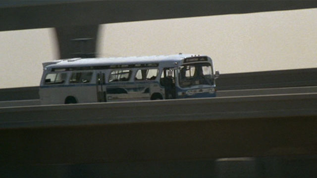 Bus approaching gap in freeway.
