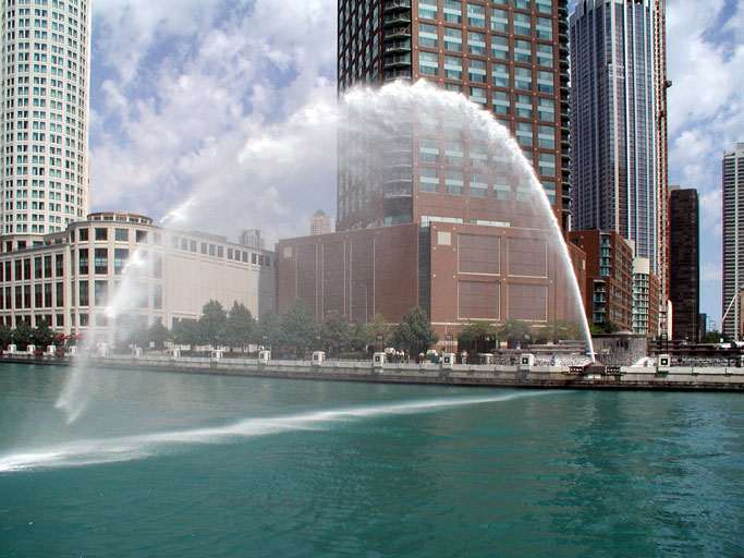 A jet of water projected over the Chicago River from one bank to the other