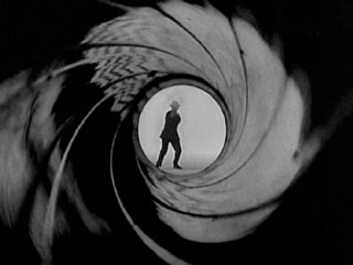 Looking out from the inside of a rifled barrel. From the opening of every James Bond film.
